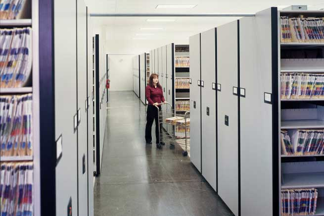 woman shelving medical files